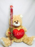 LARGE TEDDY BEAR WITH A SINGLE ROSE